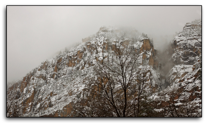 Red rocks, snow, and mist...